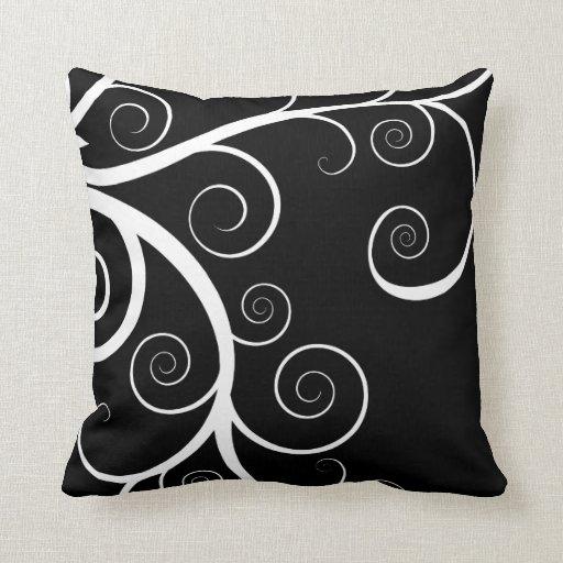 White swirls on black drawing pillows