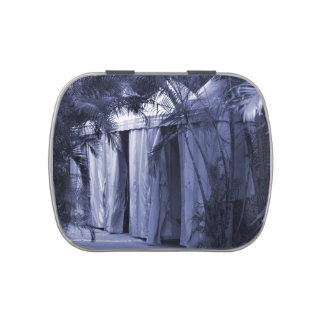 white tents behind palm fronds blue.jpg candy tins