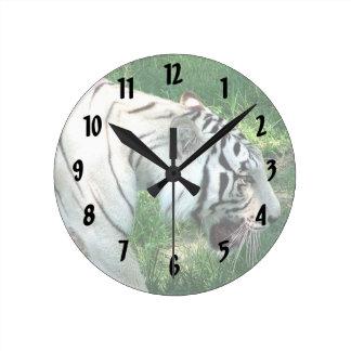 White Tiger walking by Susan L Marsh Round Clock