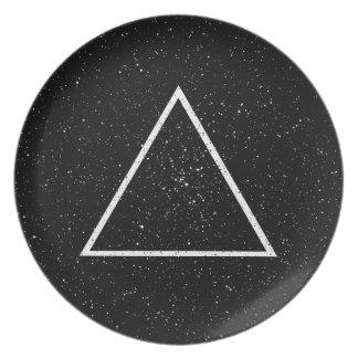 White triangle outline on black star background dinner plate