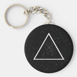 White triangle outline on black star background keychain