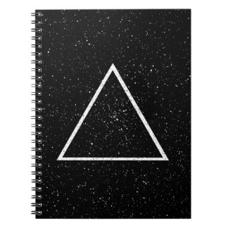 White triangle outline on black star background notebook