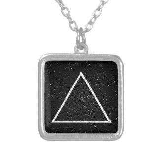White triangle outline on black star background silver plated necklace