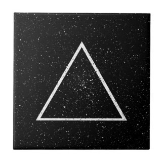 White triangle outline on black star background tile