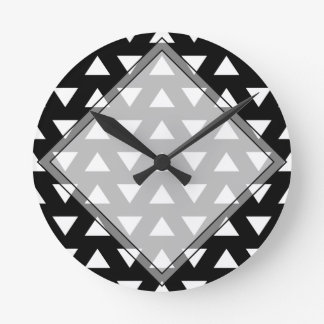 White Triangles on Black. A geometric Pattern. Round Clocks