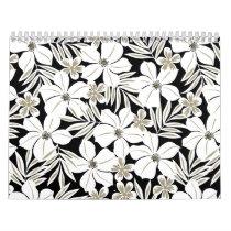 White tropical flowers on black calendar