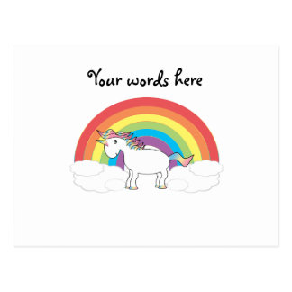 White unicorn on rainbow and clouds postcard