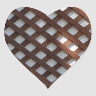 White wall covered with brown wood strips heart sticker