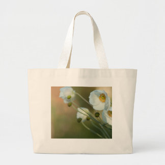 white windflowers in a natural display bags