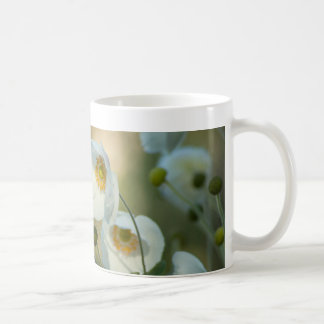 white windflowers in a natural display classic white coffee mug