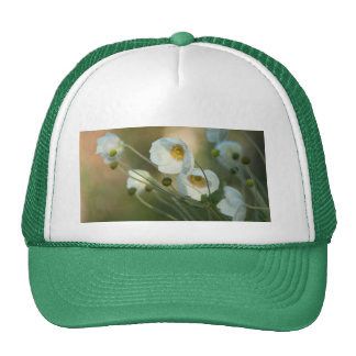 White windflowers in a natural display trucker hat
