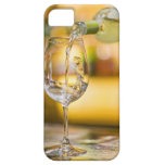 White wine is poured from bottle in restaurant. iPhone 5 case