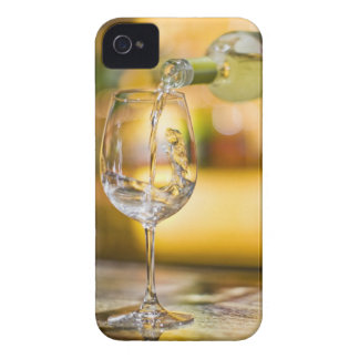 White wine is poured from bottle in restaurant. iPhone 4 Case-Mate case