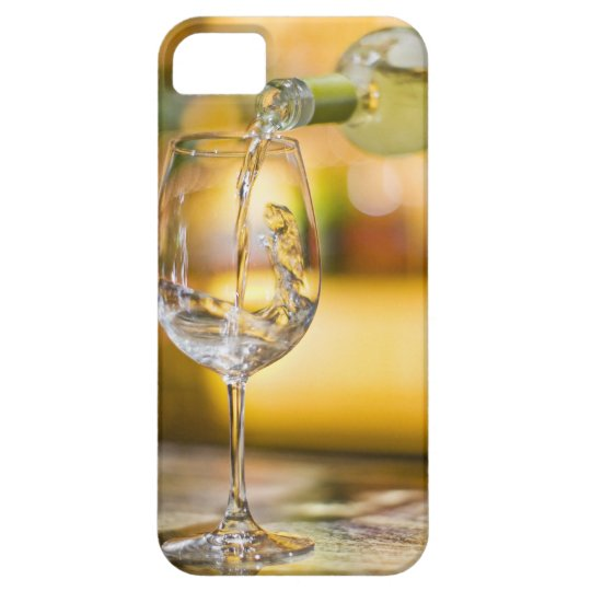 White wine is poured from bottle in restaurant. iPhone SE/5/5s case