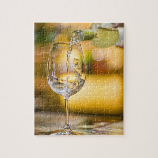 White wine is poured from bottle in restaurant. jigsaw puzzle