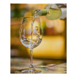 White wine is poured from bottle in restaurant. print