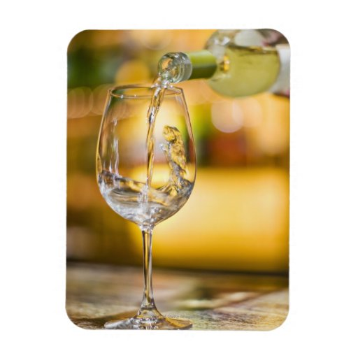 White wine is poured from bottle in restaurant. vinyl magnets