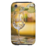 White wine is poured from bottle in restaurant. tough iPhone 3 case