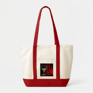 White wine on red curtain background bag