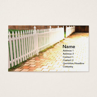 white wood picket fence by brick walkway business card