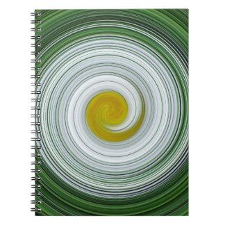 White, yellow, green spiral pattern spiral note books