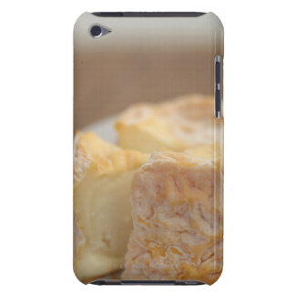 Whole of cheese on table iPod Case-Mate case
