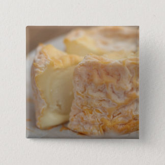 Whole of cheese on table pinback button