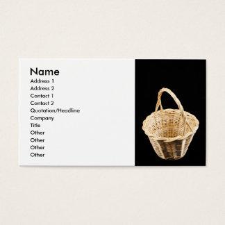Wicker basket on black background business card