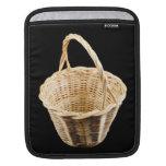 Wicker basket on black background iPad sleeves