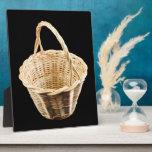 Wicker basket on black background plaques