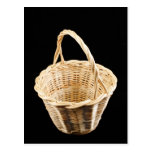 Wicker basket on black background post cards