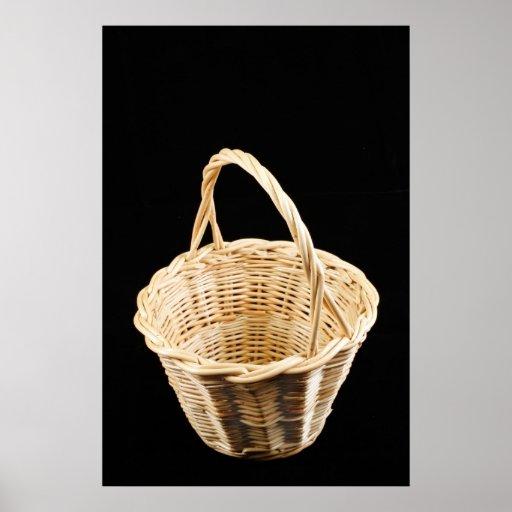 Wicker basket on black background poster
