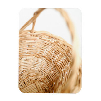 Wicker basket on white background magnet