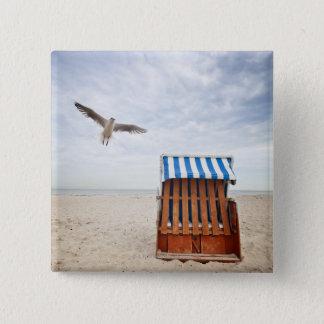 Wicker beach chair on beach button