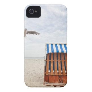 Wicker beach chair on beach iPhone 4 case
