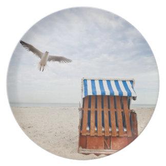 Wicker beach chair on beach plate