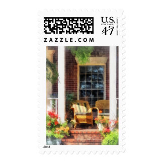 Wicker Chair With Striped Pillow Postage