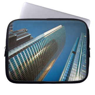 Wide-angle shot looking up at gleaming glass laptop sleeve