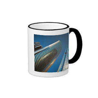 Wide-angle shot looking up at gleaming glass coffee mugs