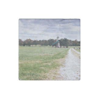 wide green meadow footpaths stone magnet