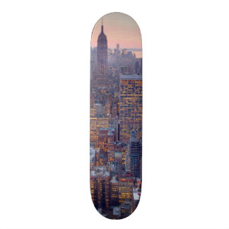 Wide view of Manhattan at sunset Skateboard