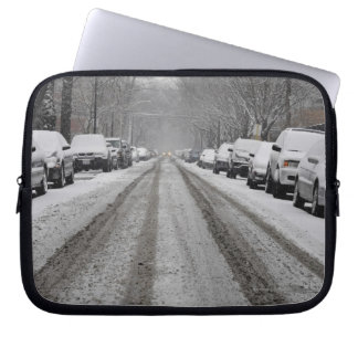 Wide view of unplowed snow covered street in laptop sleeve