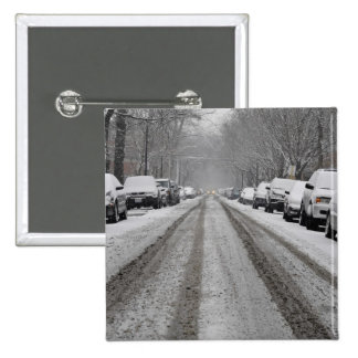 Wide view of unplowed snow covered street in pinback button
