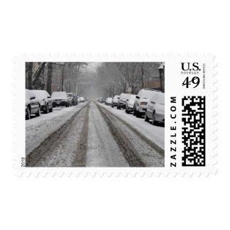 Wide view of unplowed snow covered street in postage stamp