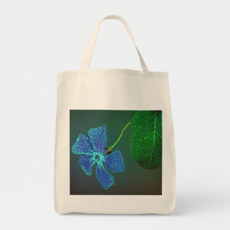 Wild flower on a grocery tote