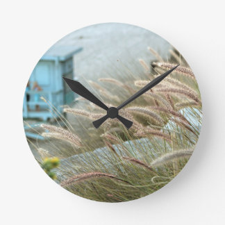 Wild grasses on Malibu beach California Round Clock