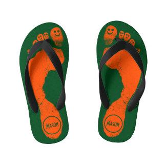 Wild Orange Footprints Smiley-Toes™ on Grass Green Kid's Flip Flops