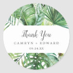 "Wild Tropical Palm Thank You Wedding Favor Sticker<br><div class=""desc"">These wild tropical palm thank you wedding favor stickers are perfect for a beach or destination wedding reception. The design features an exotic array of green watercolor banana palm tree leaves, ferns, foliage, botanical plants and greenery for a tropical summer feel. Personalize the sticker labels with your names, the event...</div>"