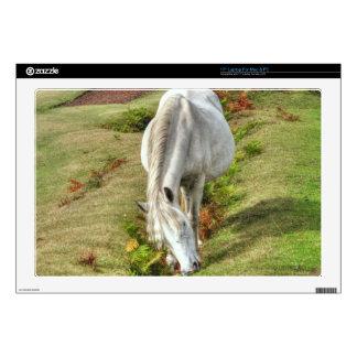 Wild White New Forest Pony Grazing on Bracken Skins For Laptops