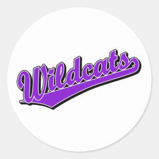 Wildcats script logo in purple round stickers